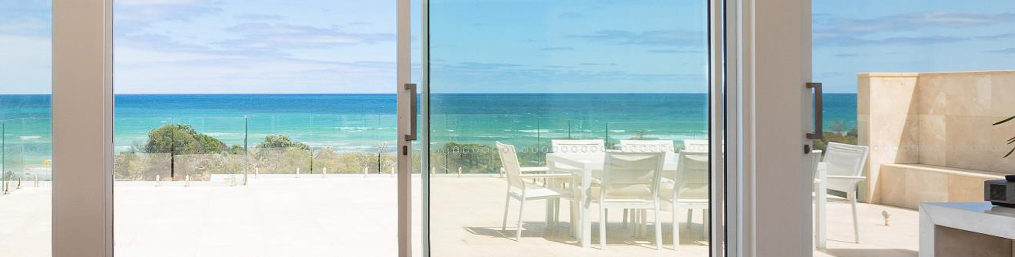 aluminium sliding doors to beach view